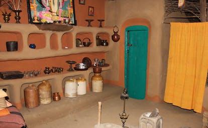 Ulpotha Sri Lanka Ayurveda treatment room with jars turquoise door and yellow curtain