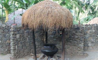 Ulpotha Sri Lanka Ayurveda water cauldron stone walls thatched cover cast iron cauldron