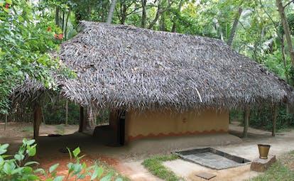 Ulpotha Sri Lanka bathroom hut thatched roof hut forest
