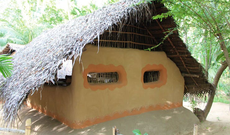 Ulpotha Sri Lanka bungalow traditional architecture wooden thatched roof