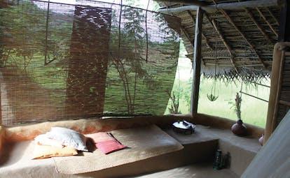 Ulpotha Sri Lanka hut lounge sleeping hut thatched walls sitting area
