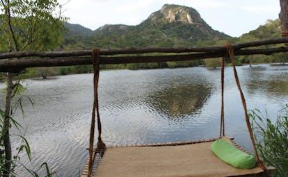 Ulpotha Sri Lanka lake view hammock next to lake mountain view
