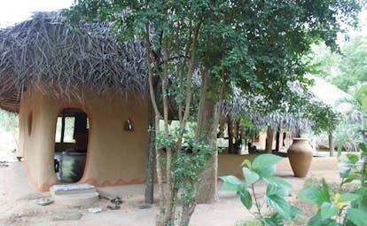 Ulpotha Sri Lanka yoga pavilion wooden hut thatched roof urn trees
