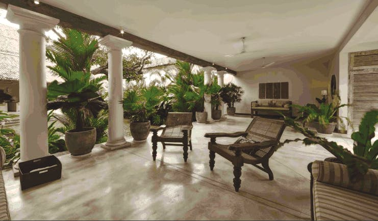 20 Middle Street Sri Lanka patio communal seating area chairs columns potted plants