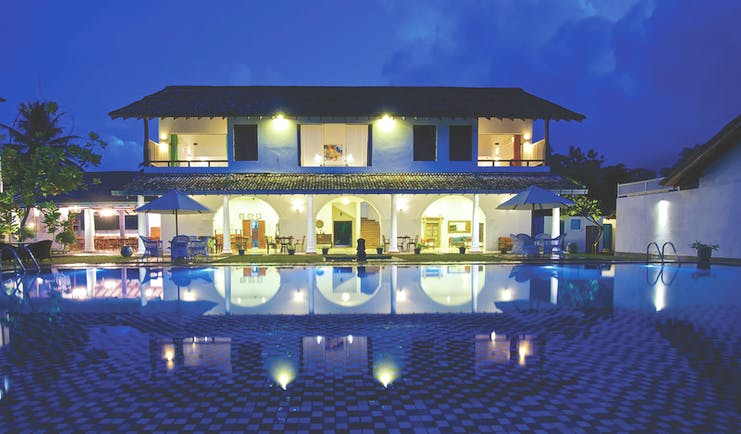 Amaloh by Jetwing Sri Lanka hotel exterior by night hotel lit up pool
