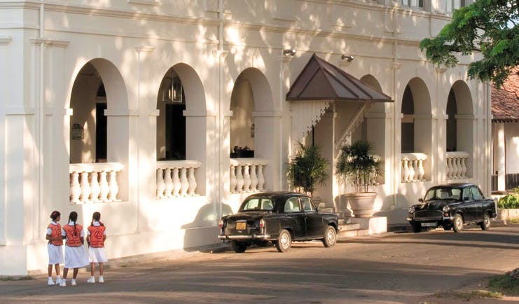 Amangalla  Sri Lanka entrance white building archways classic cars