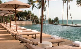 Amanwella Sri Lanka outdoor pool sun loungers umbrellas ocean view