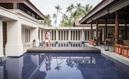 Anantara Peace Haven Tangalle Sri Lanka couple on walkway over water between lobby and spa