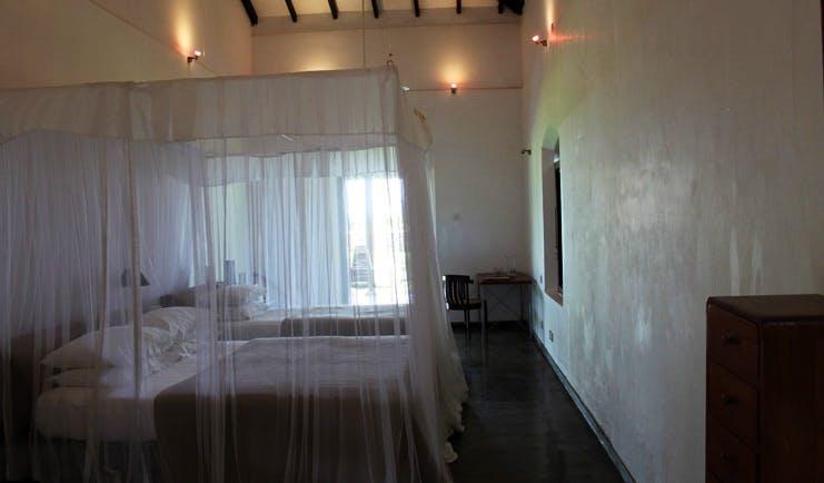Apa Villa Thalpe Sri Lanka family bedroom two white four poster beds