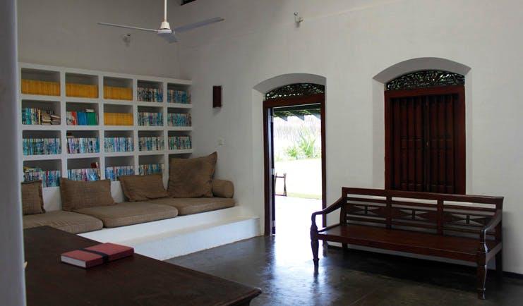 Apa Villa Thalpe Sri Lanka library white book cases and sofas