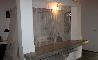 Apa Villa Thalpe Sri Lanka saffron villa bedroom four poster mosquito drapes minimalist decor