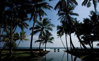 Apa Villa Thalpe Sri Lanka sea view infinity pool trees garden lounger
