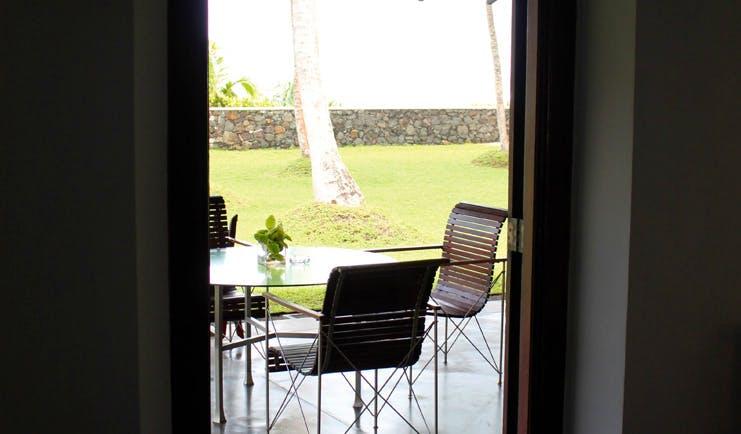 Apa Villa Thalpe Sri Lanka doorway with chairs on patio