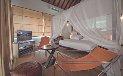 Casa Colombo Mirissa Sri Lanka beach access suite canopied bed chairs modern decor
