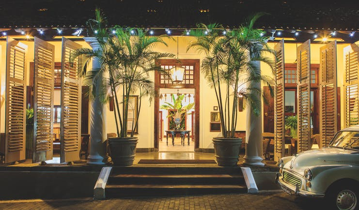 Galle Fort Hotel entrance, stairs to hotel doors, classic car, palm trees