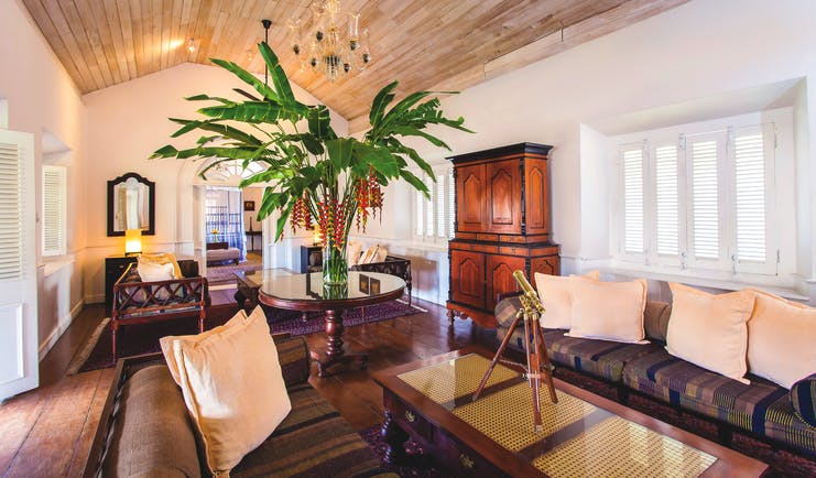 Galle Fort Hotel grand apartment lounge, sofa, glass table, elegant decor, antique furniture