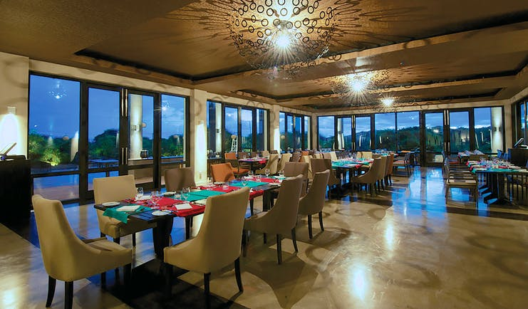 Jetwing Yala restaurant, tables and chairs, modern decor, large windows offering rural views