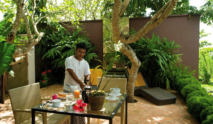 Kahanda Kanda Sri Lanka breakfast peacock garden waiter preparing breakfast in garden terrace