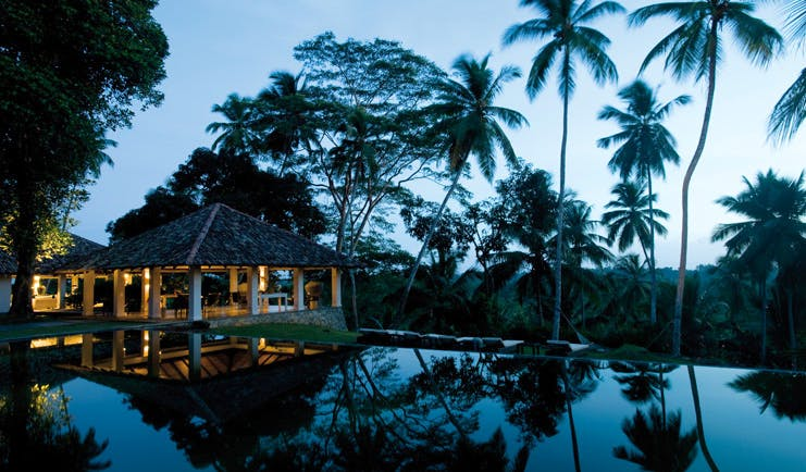 Kahanda Kanda Sri Lanka dining pavilion exterior at night time with pool view