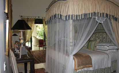 Kahanda Kanda Sri Lanka garden suite bedroom with four poster bed drapes and patio