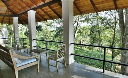 Kahanda Kanda Sri Lanka mango suite terrace with sofa and forest view