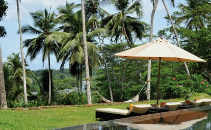 Kahanda Kanda Sri Lanka outdoor pool hammock sun loungers umbrellas