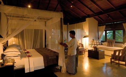 Kahanda Kanda Sri Lanka peacock suite evening man preparing room for night