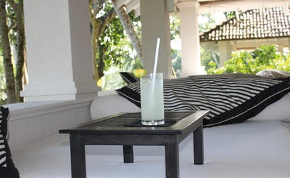 Kahanda Kanda Sri Lanka refreshment seating area with small table and lemonade