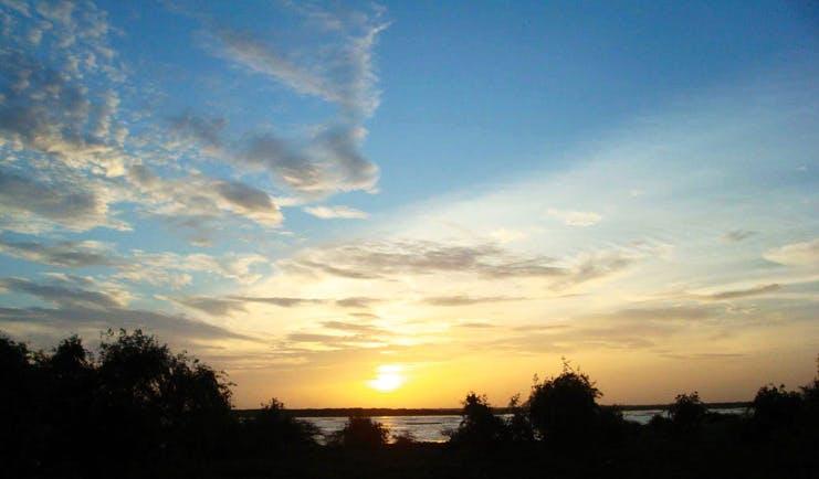 Mahoora Luxury Safari Camps Sri Lanka sunset over nature and water