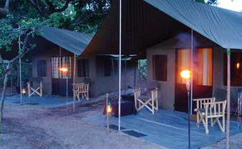 Mahoora Luxury Safari Camps Sri Lanka  tents exterior in nature deck chairs lamps