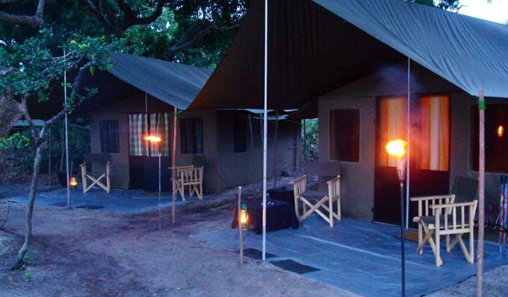 Mahoora Luxury Safari Camps Sri Lanka  tents exterior in nature deck chairs lamps