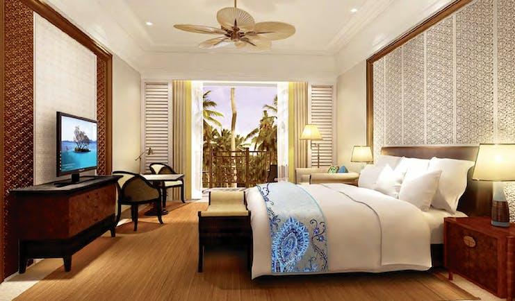 Shangri La Hambantota Sri Lanka guest room bed sofa television bright modern décor