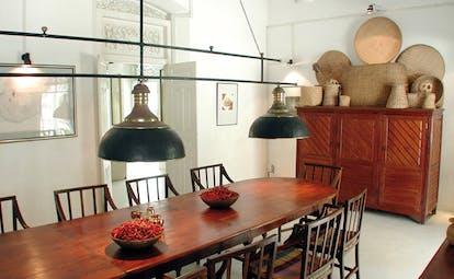 The Sun House Sri Lanka dining room long dining table bowls of chillis
