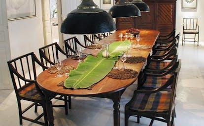 The Sun House Sri Lanka dining room with long table and banana leaf runner