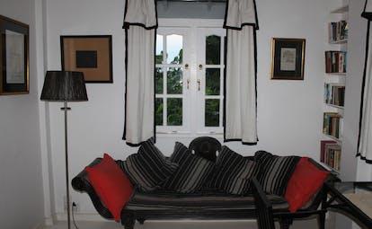 The Sun House Sri Lanka Dumas suite lounge with sofa and window