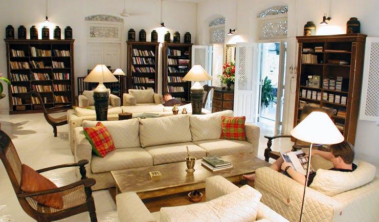 The Sun House Sri Lanka library lounge with bookshelves and sofas