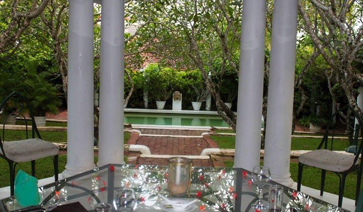 The Sun House Sri Lanka restaurant terrace with garden and pool view