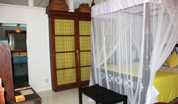 The Sun House Sri Lanka Sun and Sky suite bedroom four poster bed with white drapes