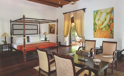 Tamarind Hill Sri Lanka admiral suite four poster bed table and chairs grand décor
