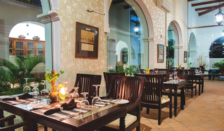 Tamarind Hill Sri Lanka indoor dining area tables chairs traditional décor