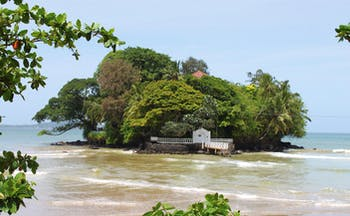 Taprobane Island Sri Lanka island trees jetty and villa rooftop