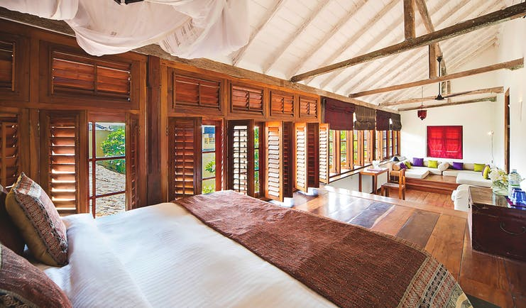 The Fort Printers headmaster suite, bed, lounge area, shuttered windows, cosy decor