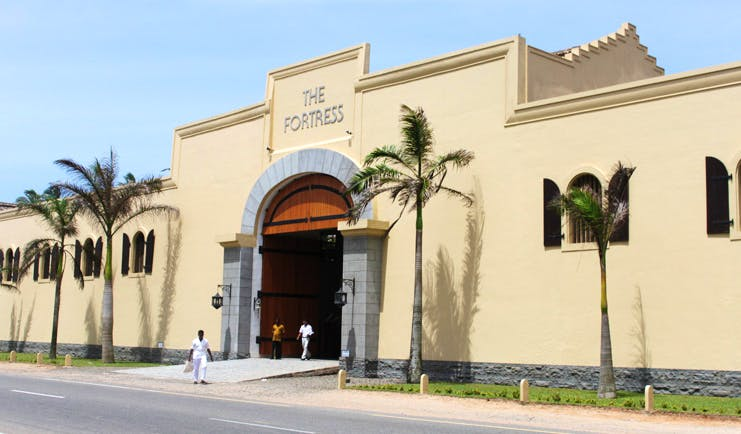 Exterior with palm trees outside and cream coloured building