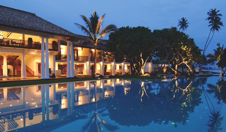 The Fortress Sri Lanka outdoor pool at night trees hotel exterior