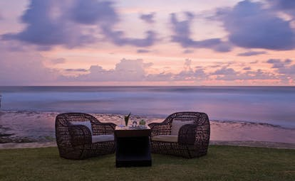 The Fortress Sri Lanka outdoor seating wicker armchairs in gardens beach view sunset