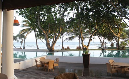 The Fortress Sri Lanka pool deck terrace area beach view hammock trees