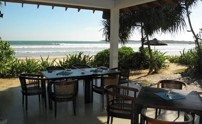 Weligama Bay Resort Sri Lanka beach bar covered outdoor dining area with beach view