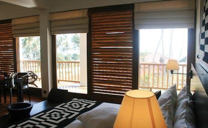 Weligama Bay Resort Sri Lanka junior suite balcony bedroom with large windows to balcony