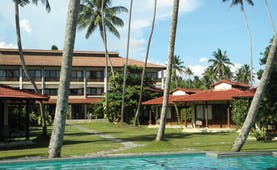 Weligama Bay Resort Sri Lanka outdoor pool with palm trees and view of bungalows and hotel