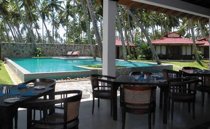 Weligama Bay Resort Sri Lanka pool bar outdoor dining area with pool view